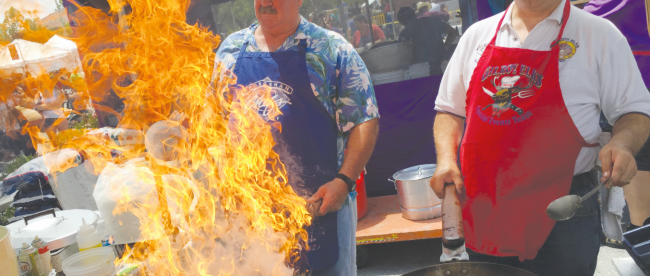 DELISH DISH John Vickory and Bruce Parker fire up the mushroom and shrimp scampi for the Gilroy Elks booth at the 36th annual Mushroom Mardi Gras.
