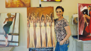 Chakamian featured with one of her paintings of dancing women.