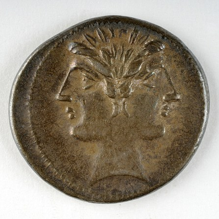 Coin depicting two-faced head