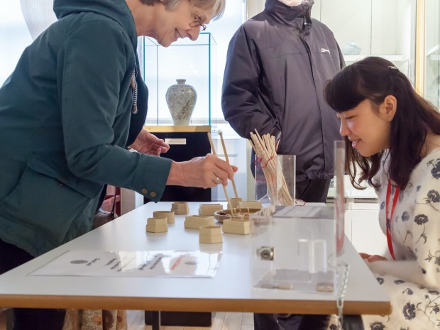 Group of three people working on exhibits