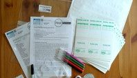 laid out partner pack with paperwork, pest trap kits, pens and other equiptment