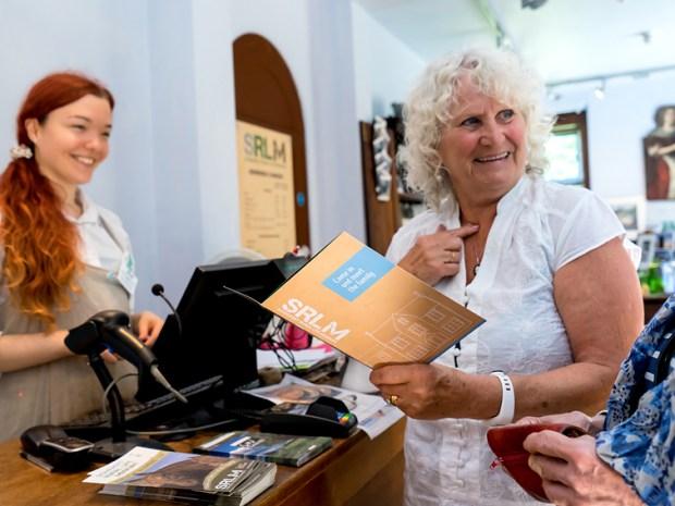 A member of staff serves a customer