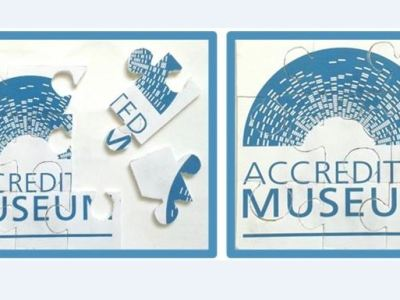 A puzzle of the Accreditation logo - uncompleted and completed