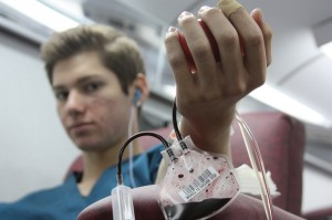Christian Baca, senior, donated his first unit of blood to the United Blood Services.<br />Photo Credit: April Bitanga