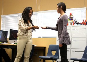 Kayla Mesina and Christen Gomez, sophomores, act out their chapters from the Hunger Games for their animation project to help visualize the chapters.Photo Credit: Allison Ho