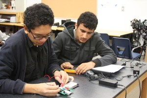 Sophomores Joshua Deleon and Aleksandar Dimitric work together to determine the voltage drops of their parallel circuits.<br/>Photo Credit: Raymond Tang