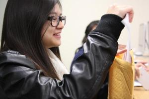 Hanna Tan places her important letters in her time capsule during her last class.Photo Credit: Jen Chiang