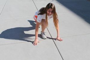 Sophomore Elizabeth Tchrenogorva gets into the starting position while practicing at school.<br>Photo Credit: Hailey Basner
