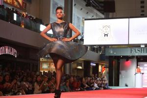 """Felicia Richardson, junior, struts her galaxy inspired dress down the Fashion Show Mall Runway for the Junior League """"Into The Magical Forest"""" 2013 Competition. .<br>Photo Credit: Michelle Manuel"""