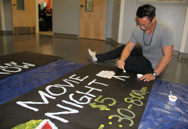 "To advertise Family Movie Night, StuCo member Karel Saquing creates posters tp put around the school. Only 400 tickets will be sold for this event. ""Movie night is an event done by StuCo with the goal to bring enjoyment to the students and their families,"" Saquing said.  Photo Credit: Acel Soriano"
