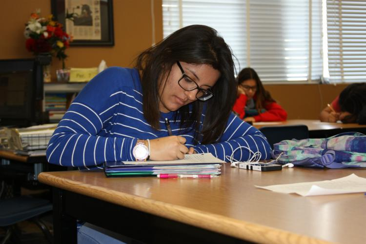 Following along to the speaker in her packet is sophomore Viviana Orizco. Listening and taking notes on her packet help Orizco understand the material.