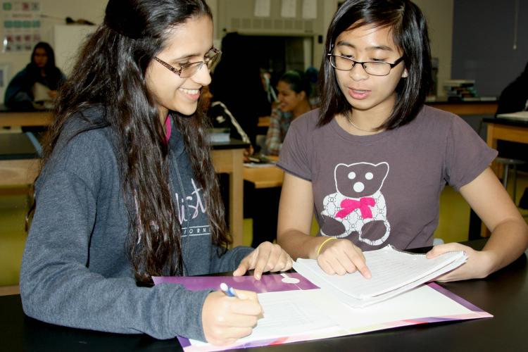 "Sophomores Julianne Torribio and Rosalia Sedano use time in class to study for their upcoming exams. ""I'm glad that my teacher gave us a few minutes to study for the exam, without it I would've had a hard time on the exam,"" Torribio said."