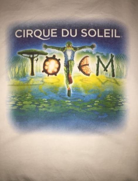 """Cirque Du Soleil merch shirt designed by Buiniakou. Buiniakou worked on this shirt with the help of other designers. """"For five years I have been designing posters and shirts,"""" Buiniakou said. """"After two years, I will move to a new company for a full time contract."""""""