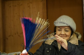 Vendor at Freyung demonstrates her materials, one of the best Vienna Christmas Markets.