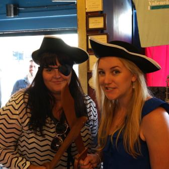 Jenny and Anne sporting pirate hats.
