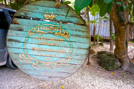The turquoisee and gold sign of La Troupe, one of my favorite Tulum shops.