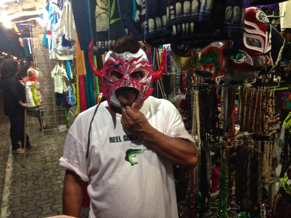 We met a friendly vendor who modelled lucha libre masks. (Tulum town).