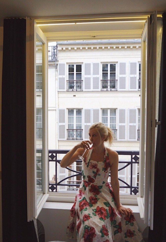 A glass of champagne on the window sill feels so Parisian.