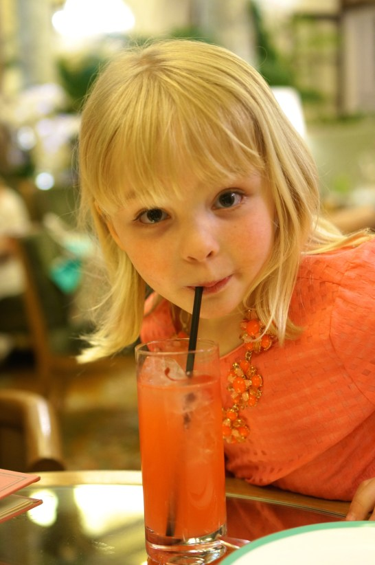 Avery enjoying the pink lemonade.