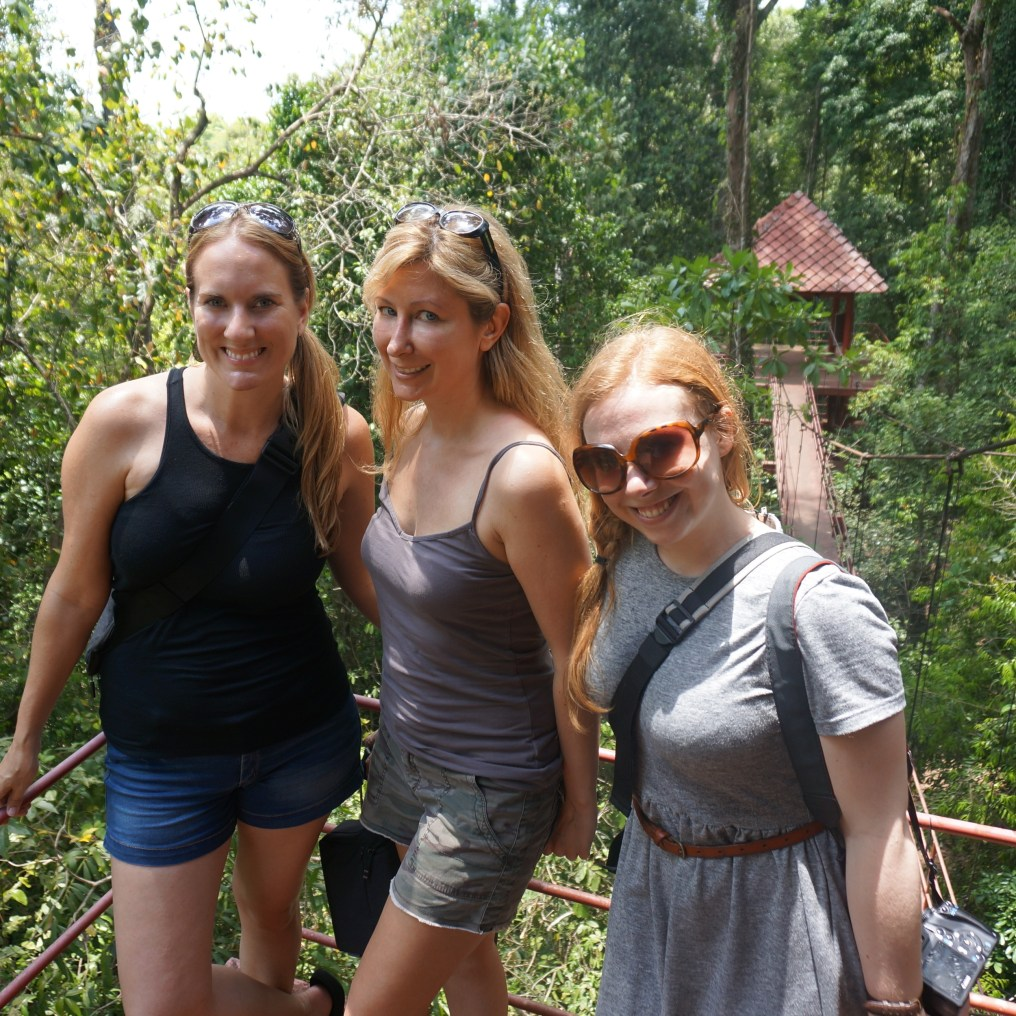 Striking a pose in Trang's botanical garden with Toccara and Jessica.