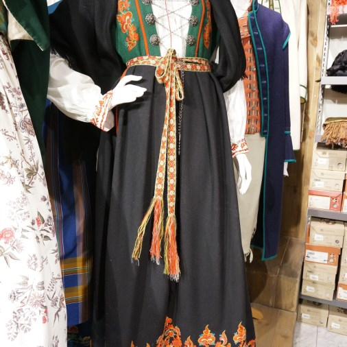 I tried on a traditional Norwegian dress, not realizing it was actually a sample and not available for immediate purchase. These dresses are made to order and take six months to prepare.