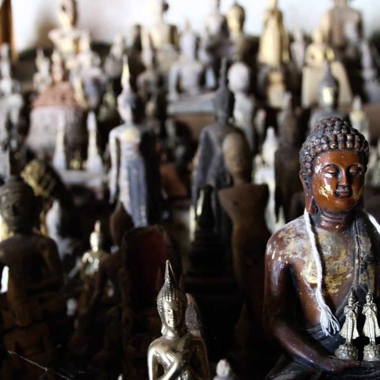 Small Buddha statues in a cave off the Mekong river in Laos