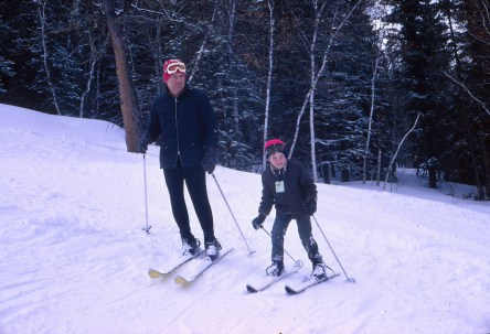 My dad playing ski instructor with me at age 7