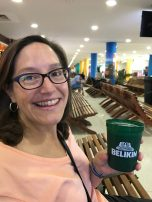 Souzz wasted no time, enjoys a beer at Belize International while we wait for our commuter flight to Placencia