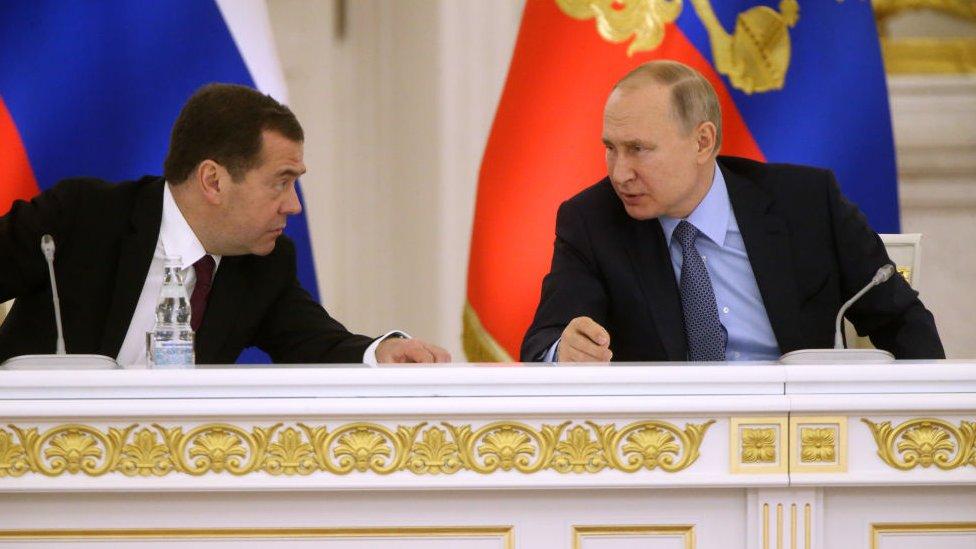 Медведев и Путин