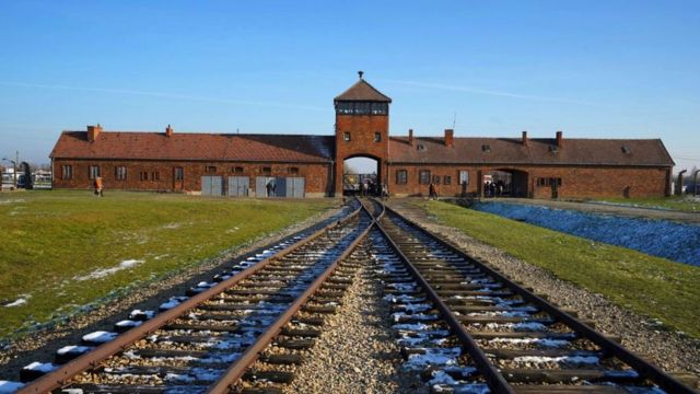 The railway tracks entering the main building at the Auschwitz-Birkenau German Nazi death camp.