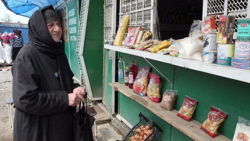Женщина на рынке в Гали