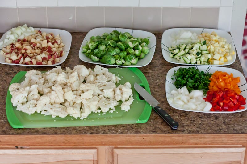 All vegetables chopped and on different plates for meal prep