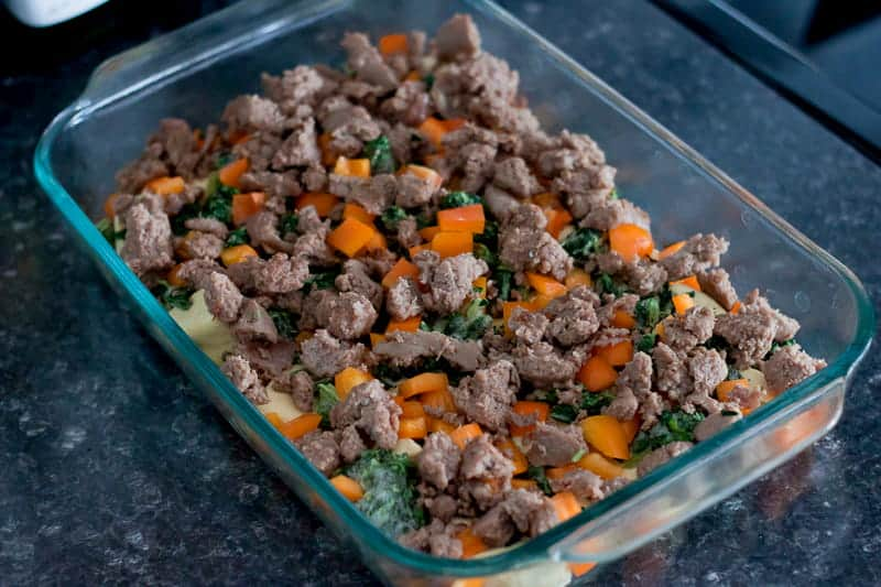 Baking dish with biscuits, vegetables, and turkey breakfast sausage