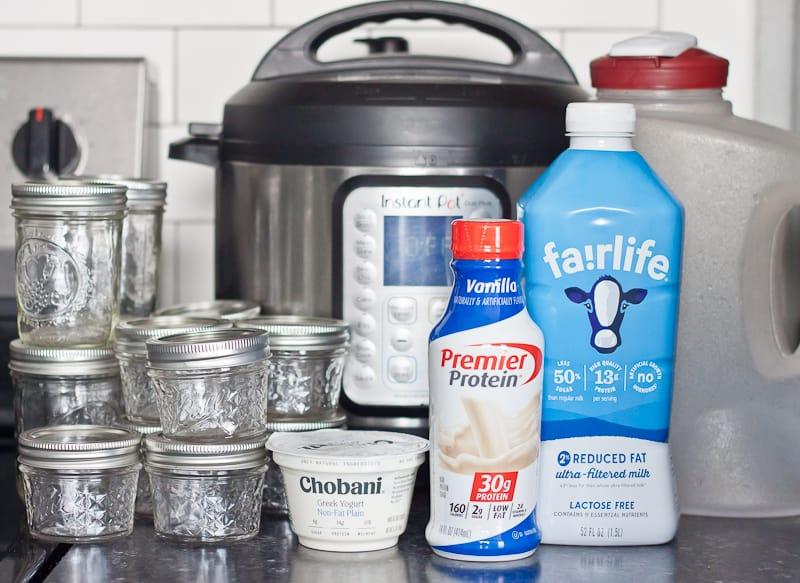 Instant Pot, empty mason jars, plain Chobani, vanilla Premier Protein shake, Fairlife milk, and plastic pitcher
