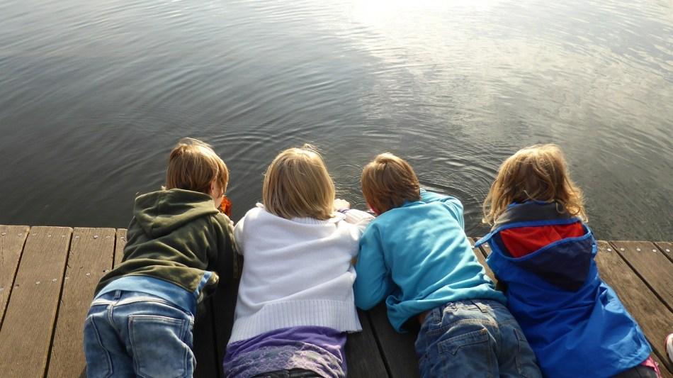 Kids playing at the lake