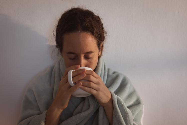 Sick Caucasian woman self isolating and social distancing in quarantine lockdown during coronavirus