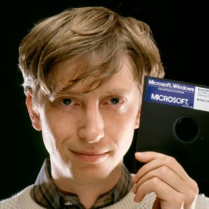1985, Bellevue, Washington, USA --- Bill Gates, CEO of Microsoft, holds a Windows 1.0 floppy disk soon after its release. --- Image by © Deborah Feingold/Corbis