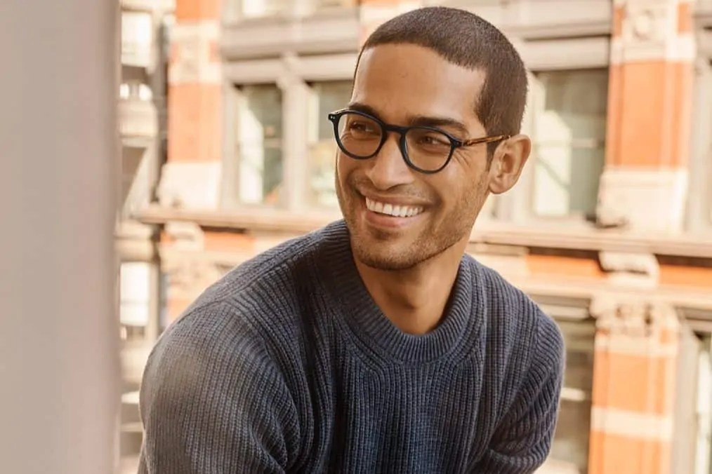 man wearing warby parker glasses