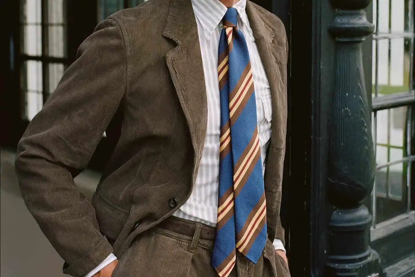 A man wearing a tweed suit