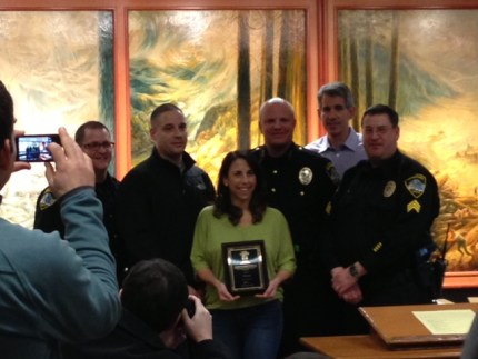 Tia Borgioli with bravery award and Snoqualmie Police and Mayor, 1/14/13