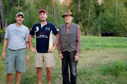 Mike Akers, his husband Jim, and cows' owner, Herman. Cows in background at their Indian Hill Snoqualmie home.