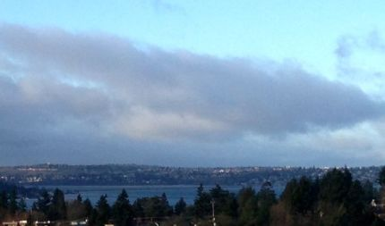 Partly sunny skies over Lake Washington Sunday morning, 2/16/14, aren't expected to last long as 2nd strong storm approaches