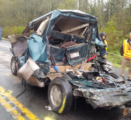 Chevy Astro Van after being   struck by semi truck in a collision on SR 18 near I-90, on 10/28/14.  Photo:  WSP Twitter Feed