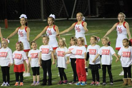 Mini Cheer Camp attendees performing at halftime of the 10/3/14 MSHS football game.