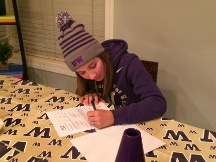 Madison Mariani signing her letter of intent to join the UW Women's Crew Team next fall.