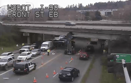 Garbage truck lift arm stuck in Front Street I-90 overpass, Friday morning, 3/13/15. Photo: WSDOT
