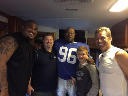 Seahawks Hall of Fame [former] players Walter Jones, Cortez Kennedy and Steve Largent with residents Eric Heuston (Seahawks HR Manager) and son Aiden.