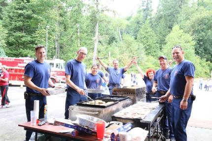 Snoqualmie firefighters cook pancakes at its annual  Railroad Days Pancake Breakfast. Photo: City of Snoqualmie