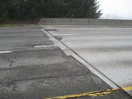 Deteriorating pavement at the bridge deck over I-90 SR 202 exit 31. Photo: WSDOT