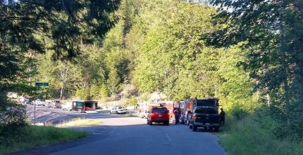 Rescue personnel near the North Fork of the Snoqualmie River in the Ernie's Grove area.
